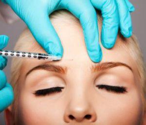 woman under going botox treatment