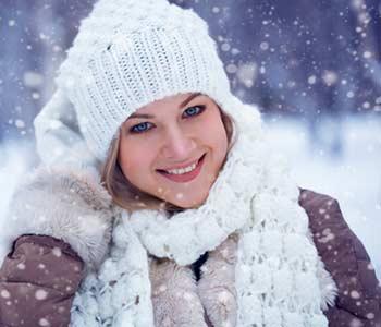 Winter closeup beautiful happy blonde woman portraits